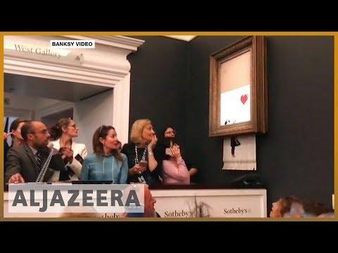 🇬🇧 Banksy painting self-destructs after $1.4 million sale | Al Jazeera English