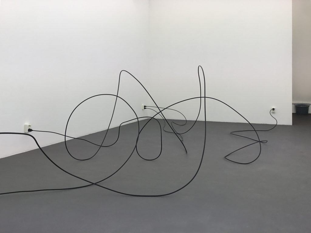 A tension cable and sockets. Installation view ELASTIC Gallery, Stockholm.