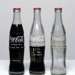 Conceptual art Cildo Meireles, Insertions into Ideological Circuits: Coca-Cola Project, 1970. Photo courtesy of Tate