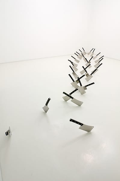 Barry Le Va, Cleaved Floor, Four Paths, 2009, 29 meat cleavers.