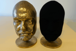 Two identical busts. One coated in Vantablack