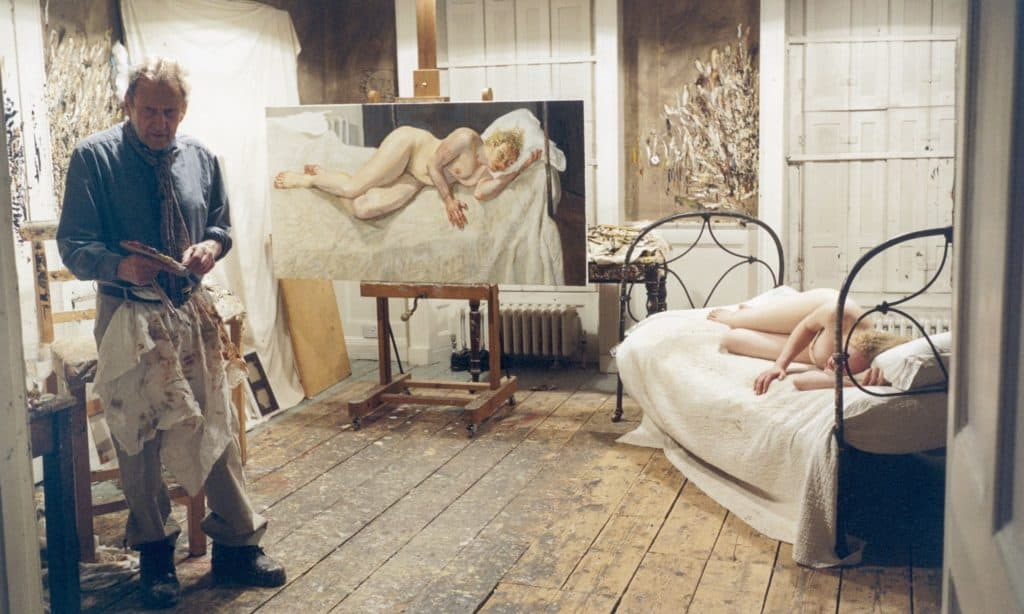 Lucian Freud in his studio with model Ria Kirby (2007)