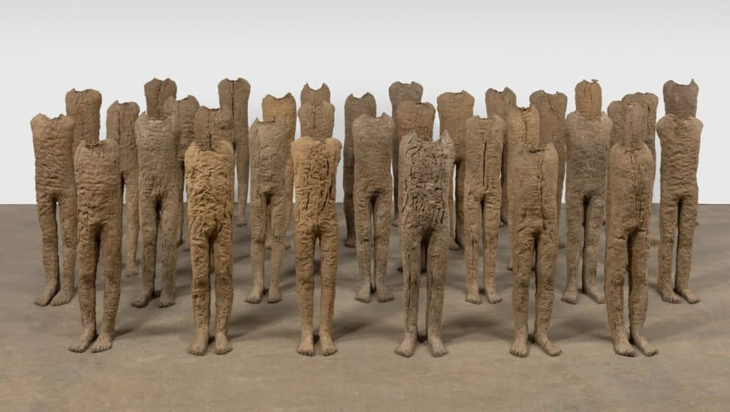 Magdalena Abakanowicz - Infants- 1992. 33 ethereal figures made of burlap and resin.