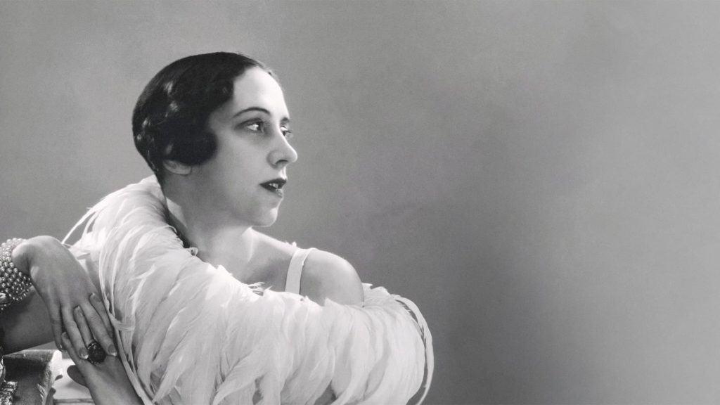 Elsa Schiaparelli wearing a feather boa (1932)