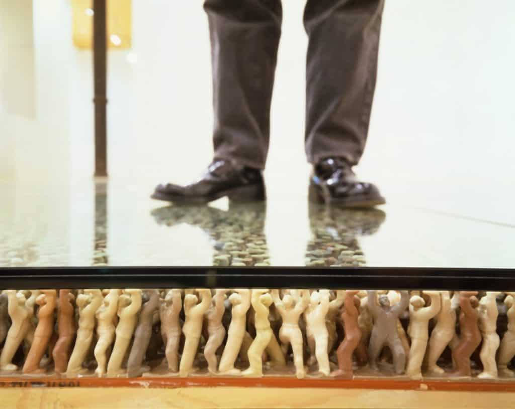 Do Ho Suh - Floor. Humanlike PVC figures supporting a glass floor.