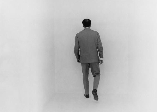 Yves Klein in the white void room. The White Cube.