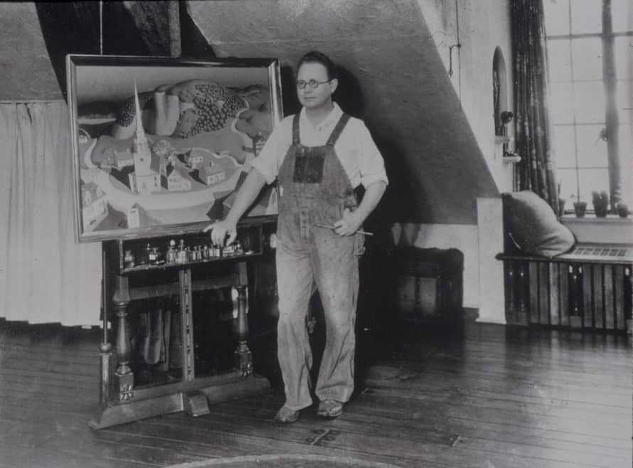 Grant Wood posing in his studio, ca. 1931. Photo credit: Cedar Rapids Museum of Art. American Gothic