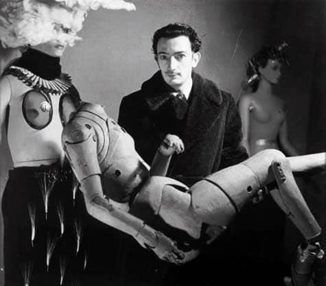 Dalì holding a mannequin, International Surrealist Exhibition, Paris, 1938. Photo: Denise Bellon
