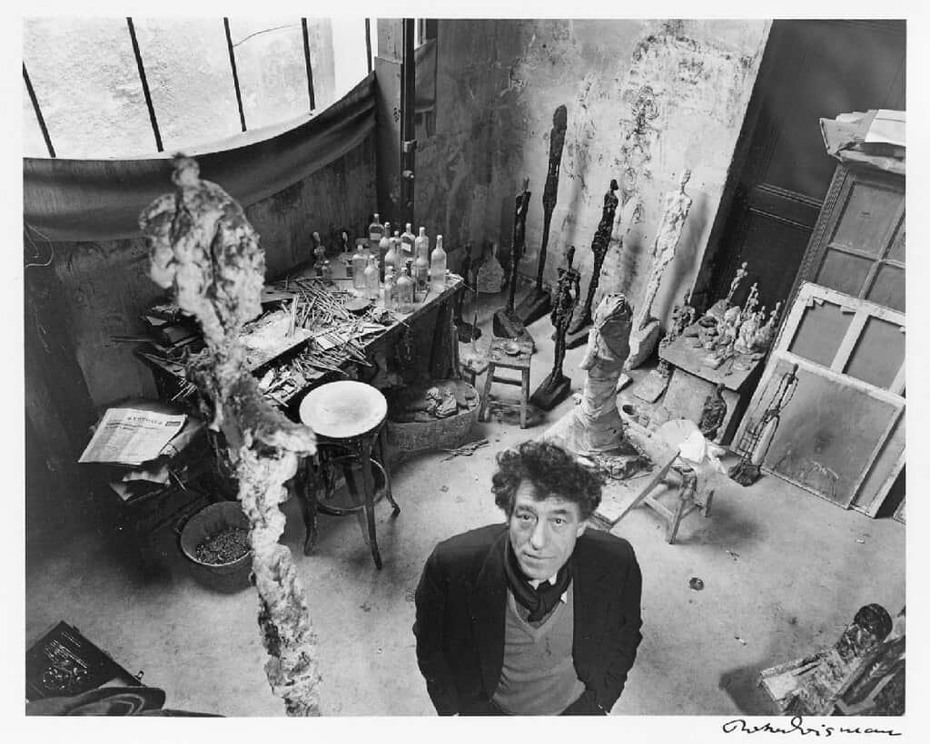 Sculptor Alberto Giacometti in his studio in Paris by Robert Doisneau.