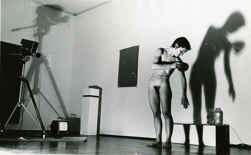 Joan Jonas performing Organic Honey's Visual Telephathy at Leo Castelli, recording with a Sony Portapak.