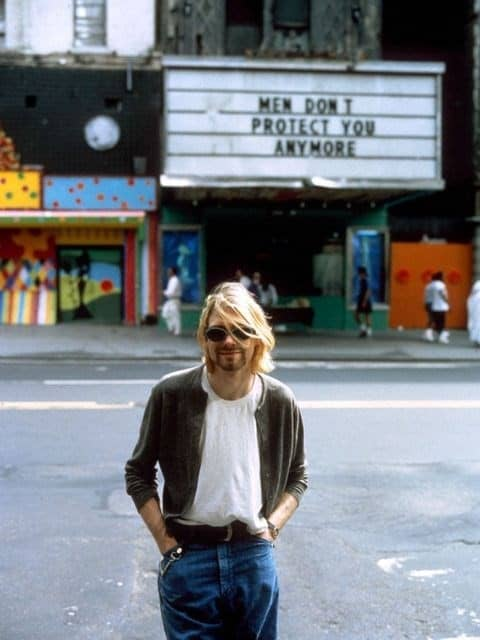 Kurt Cobain in front of Jenny Holzer's Men Don't Protect You Anymore, Truisms, Photography Stephen Sweet.