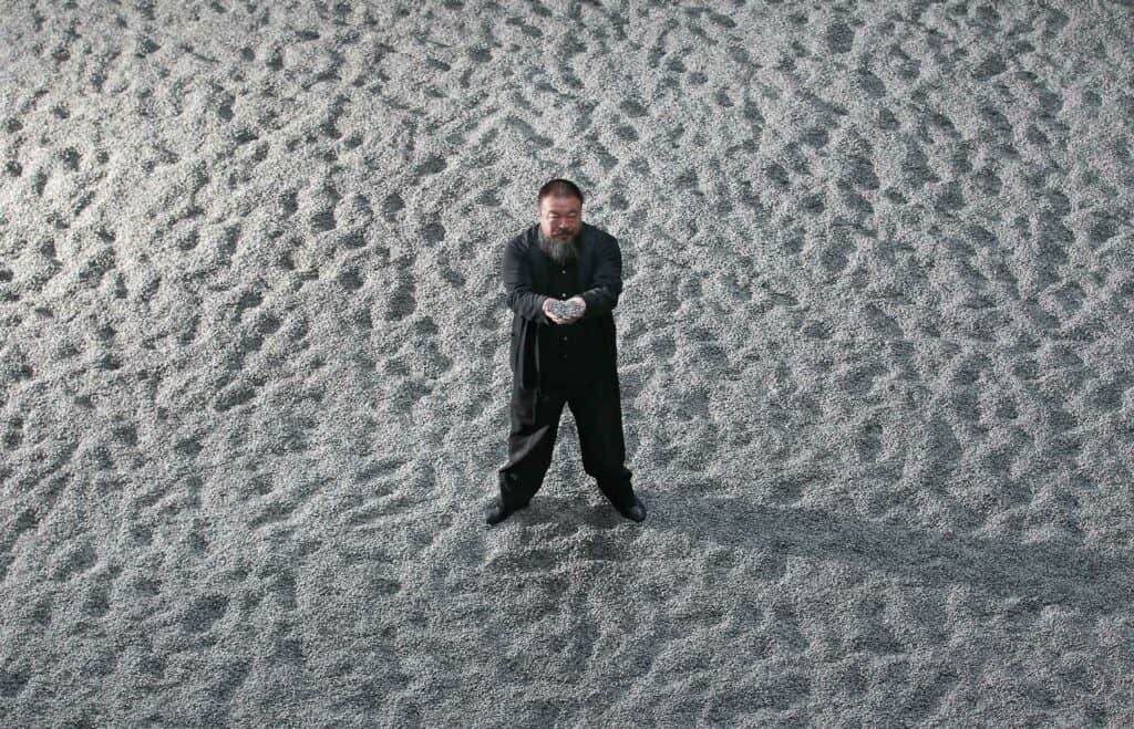 Ai Weiwei and his sunflower seeds in the Turbine Hall of the Tate Modern, via NY Times