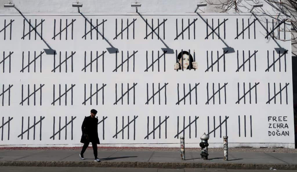 Art Censorship. NA man walks by a mural by artist Banksy supporting  jailed Turkish artist Zehra Dogan on April 18, 2018 in New York City. (Photo by Gary Hershorn)
