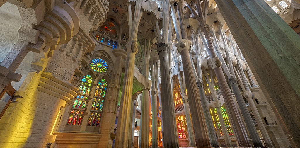 Antoni Gaudí's Sagrada Família is the most towering example of Modernisme in the world. Note its organic forms, ornamentation, and use of geometric domes and columns.