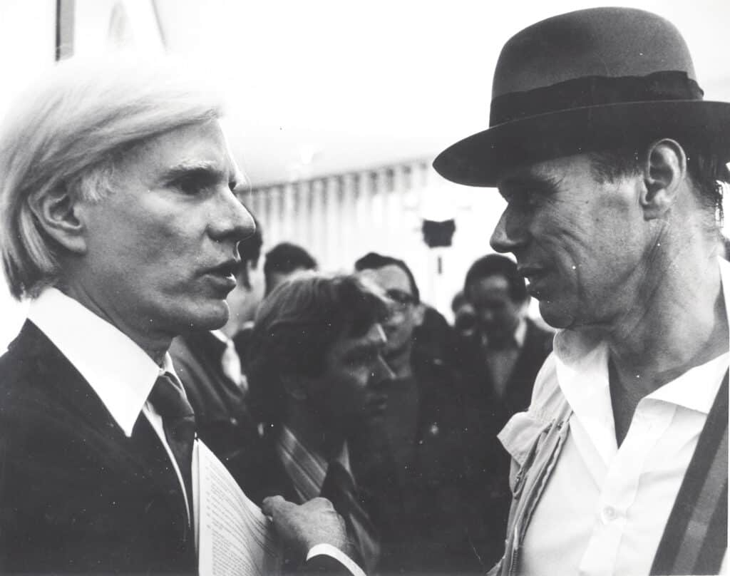 Joseph Beuys and Andy Warhol at Warhol's exhibition opening Indians, Portraits, Torsos on May 18, 1979 at the Galerie Hans Mayer. Photo: Werner Raeune. Courtesy of Beuys2021.