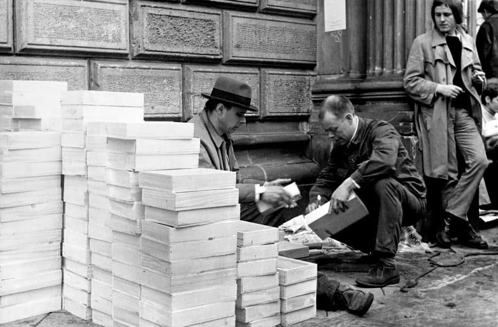 Working on intuition boxes outside Kunstakademie Düsseldorf. PhotographÁ Nino Barbieri, 1970s © VG Bild-Kunst, Bonn 2020. Courtesy of Beuys2021.