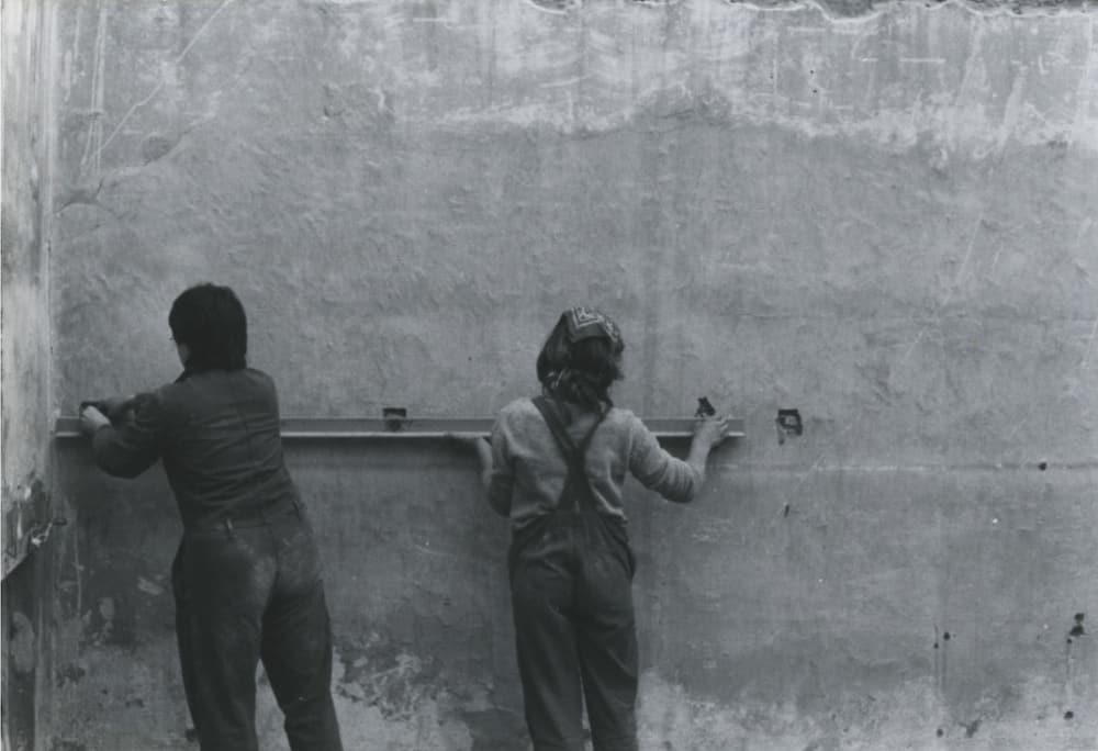 Architects Mary-Lou Ascott and Susan Francis, one of the founder members of Matrix, setting out a floor plate. Image courtesy by Matrix Feminist Design Co-operative.