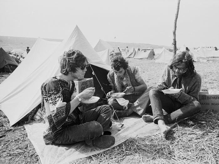 Festival-goers camping at East Afton Farm during the Isle of Wight pop festival, one of the larges music festivals at the time. (Photo by Roger Jackson/Central Press/Getty Images)