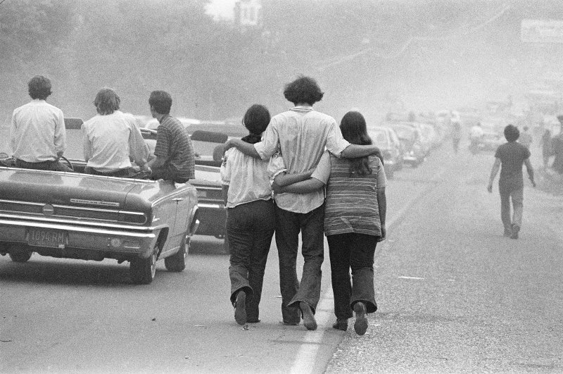 Festival-goers on their way to Woodstock, August 1969. (Photo by Baron Wolman/Getty Images)