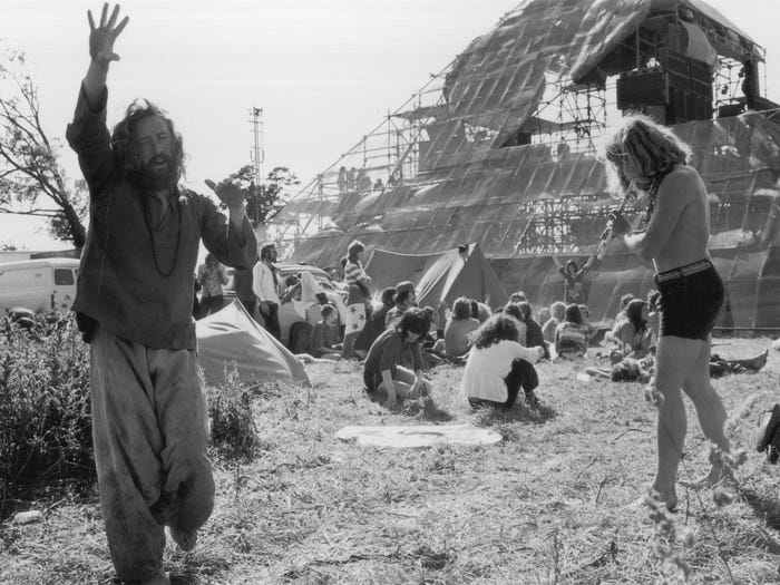 Hippies at music festivals in 1970 celebrated with music and dancing. (Photo by Ian Tyas/Keystone Features/Getty Images)