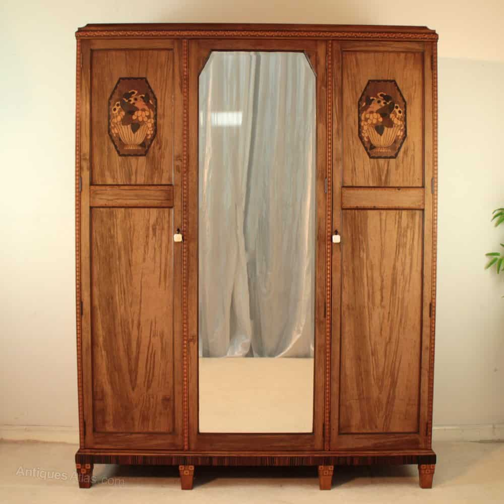 Art Deco furniture dating ca. 1925. Wardrobe made of walnut, macassar ebony with marquetry possibly by Bath Cabinet Makers.
