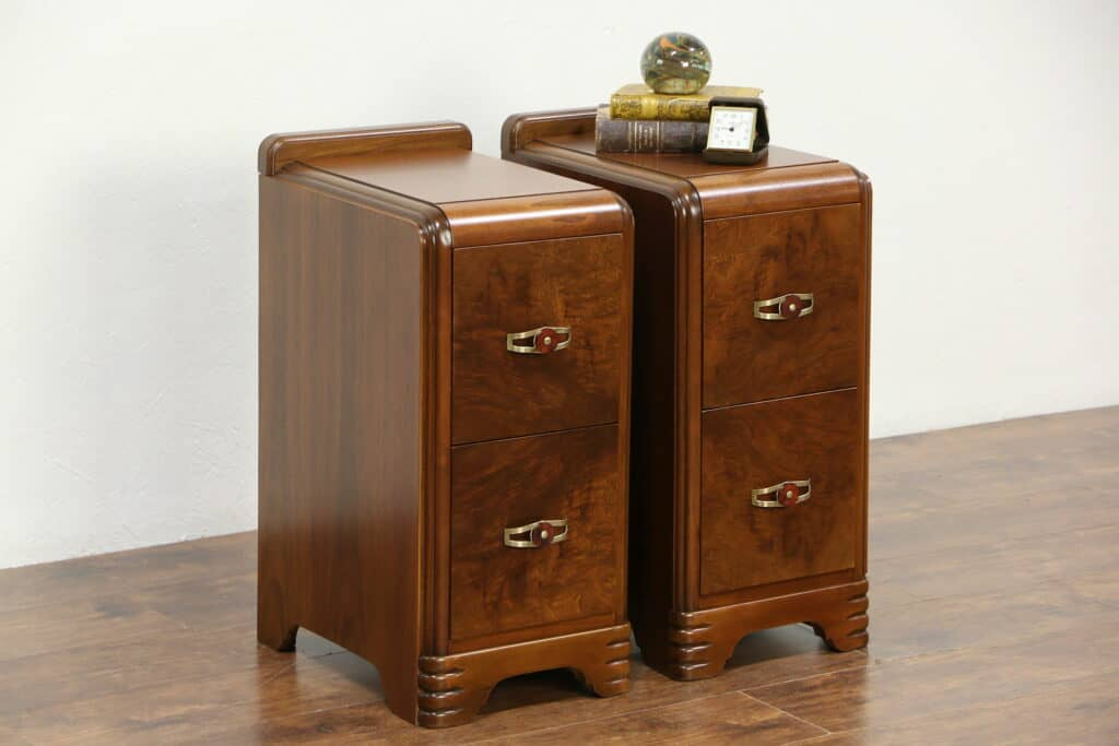 A pair of late 1930s Art Deco waterfall design walnut and matched burl nightstands.